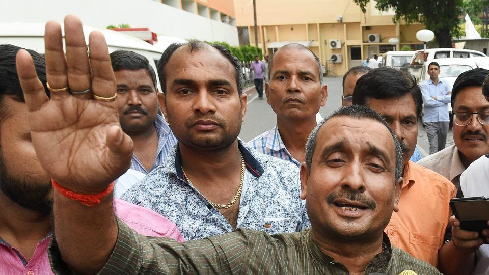 BJP MLA from Unnao Kuldip Singh Sengar speaks to the media outside the chief minister's office in Lucknow on Monday. A woman from Unnao has alleged that the legislator raped her last year. Uttar Pradesh police on Tuesday arrested Sengar's brother in connection with the alleged custodial death of the victim's father.  (Nand Kumar / PTI File)