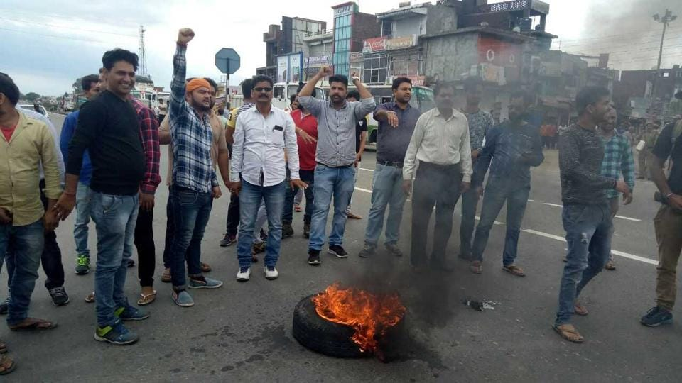 Protesters block Jammu-Pathankot highway during the bandh called by Jammu and Kashmir High Court Bar Association on Wednesday.
