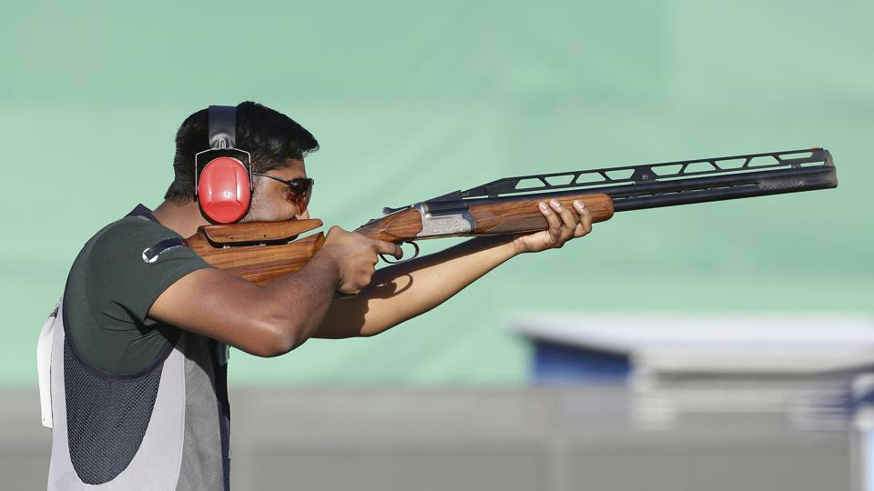 Ankur Mittal of India shoots during the men's Double Trap final at the Belmont Shooting Centre. He finished second. (AP)