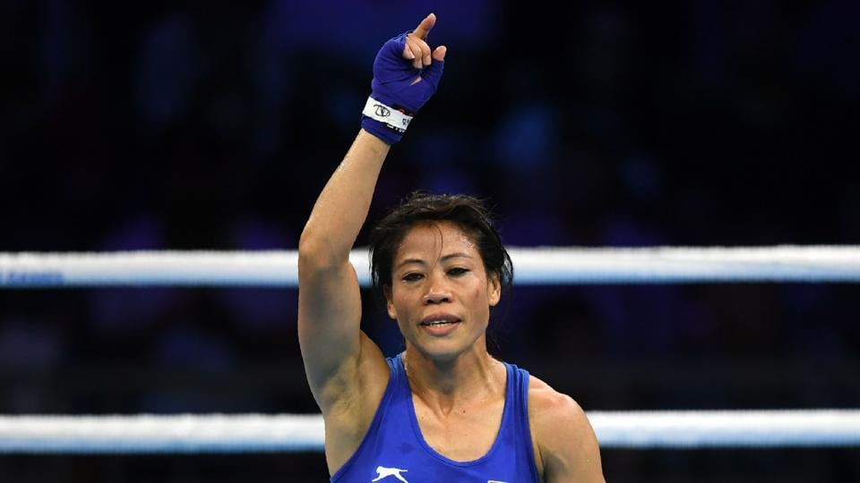 Indian boxing star MC Mary Kom advanced to the Commonwealth Games final with a comprehensive triumph over Sri Lanka's Anusha Dilrukshi Koddithuwak on Wednesday. Meanwhile India added three more medals to its tally through shooting and beat England in the men's hockey Pool B showdown. (Ye Aung Thu / AFP)