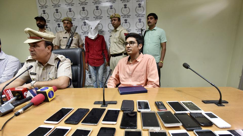 Gajender alias Gajju (face covered), started his criminal activities when he was 12 years old. He allegedly burgled shops at night and took cash, mobile phones and laptops.