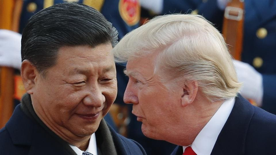 US President Donald Trump talks to Chinese President Xi Jinping during a welcome ceremony at the Great Hall of the People in Beijing last year.