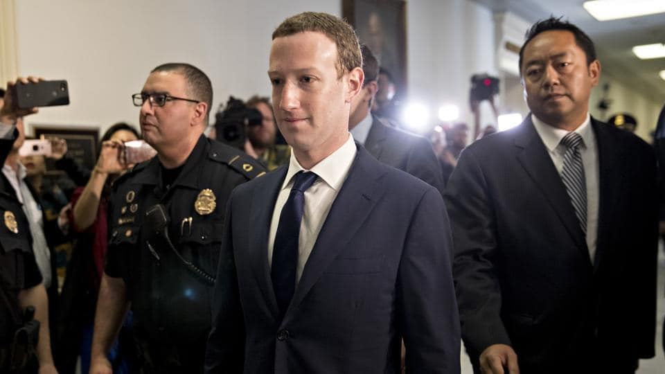 Mark Zuckerberg, chief executive officer and founder of Facebook Inc., walks through the Rayburn House Office building before a House Energy and Commerce Committee hearing in Washington, D.C. on Wednesday.