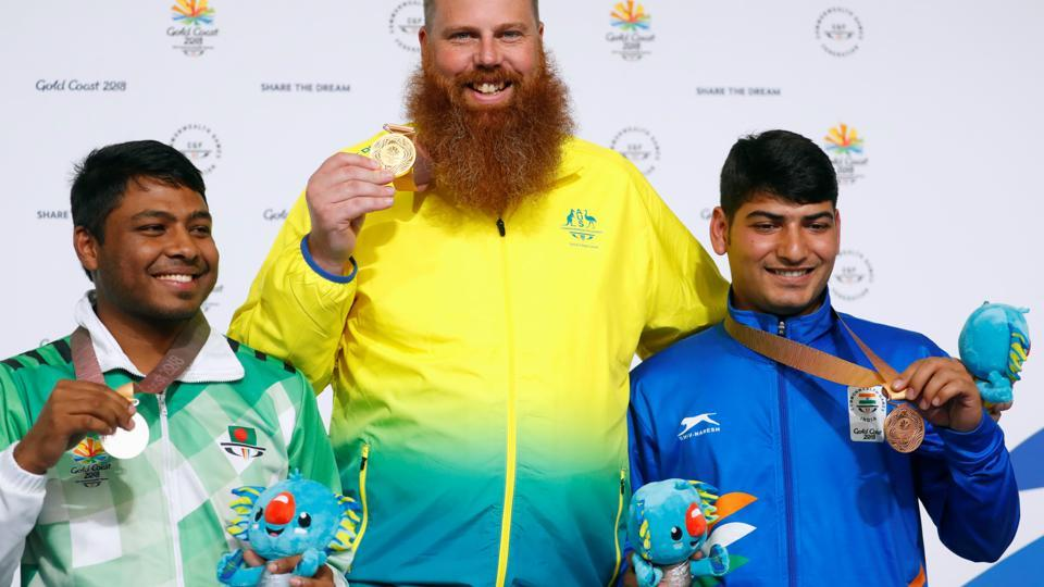 Men's 50m Pistol gold medallist Daniel Repacholi (centre) of Australia flanked by silver medallist Shakil Ahmed of Bangladesh and bronze medallist Om Mitharval of India. (REUTERS)