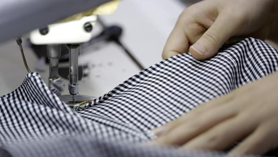 An employee uses a sewing machine while making an Original Stitch shirt at a factory operated by Koyama Choya Sewing Corp., a subsidiary of Yamaki Co., in Saku, Nagano, Japan.