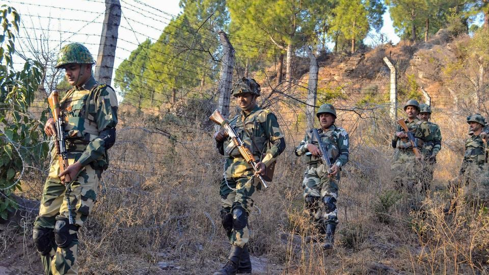 Border Security Force soldiers patrol near the Line of Control (LoC) in Poonch.