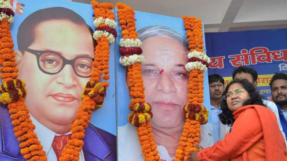 BJP MP Savitri Bai Phule offers tributes to Dalit icons Bhimrao Ambedkar and Kansiram during a rally. The BJP MP from Bahraich alleged the Centre had remained a mute spectator to atrocities against Dalits during the 'Bharat Bandh' and the Uttar Pradesh dovernment had failed to check the continuing vandalisation of Dr Bhim Rao Ambedkar's statues.