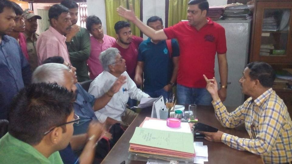 Tourists and protesters in the office of Corbett Park in Ramnagar on Wednesday.