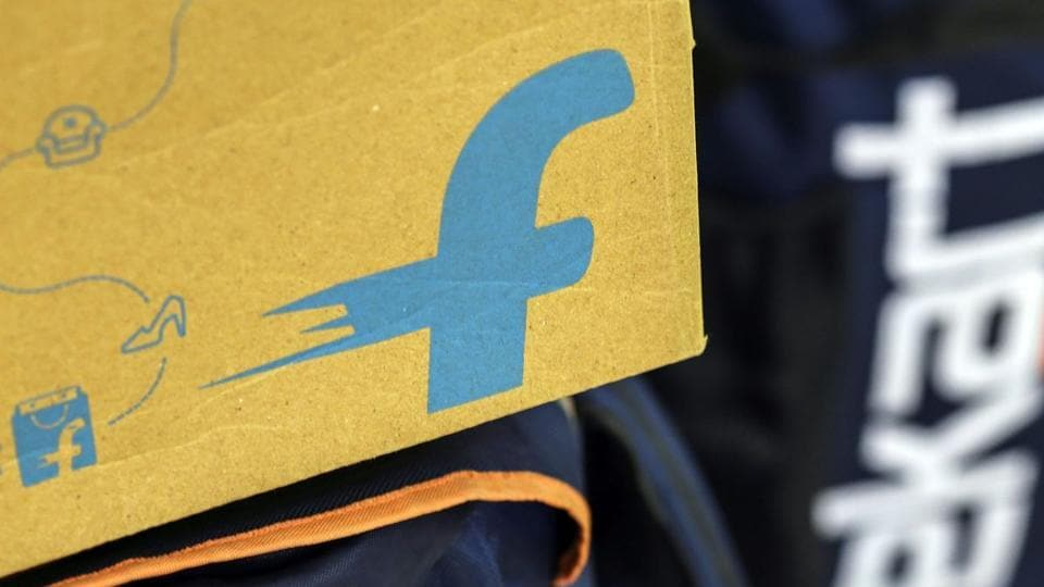 Walmart is in talks to take a minority stake in Flipkart that could go up to 50 or 60%, said the people.