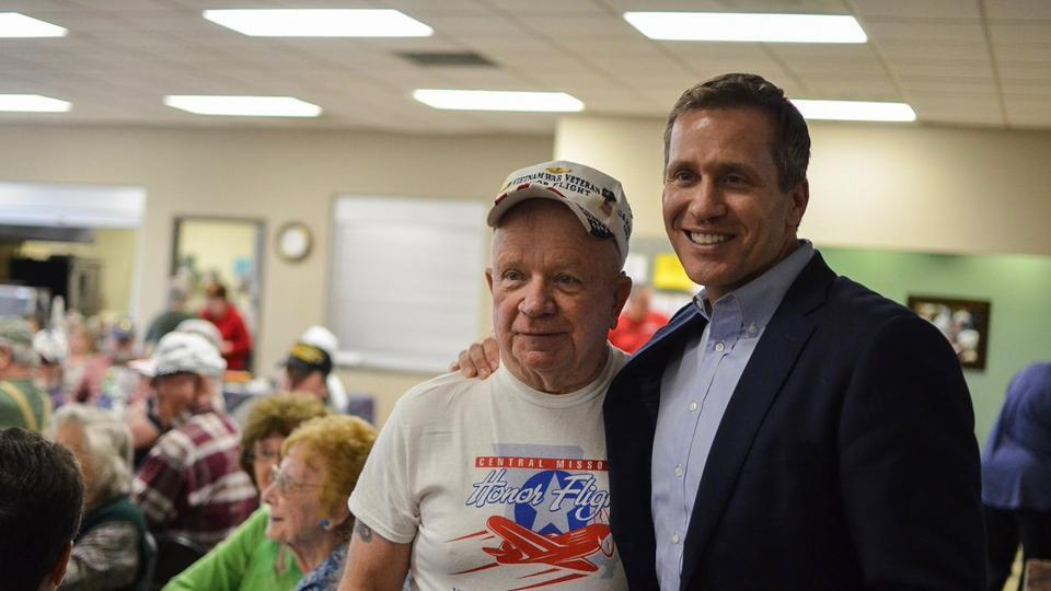 Republican Governor Eric Greitens (right) has been criminally charged with invasion of privacy and scheduled to stand trial in May.
