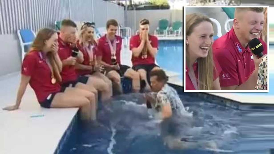 Players burst into fits of laughter as BBC reporter falls into the pool while interviewing then on live television