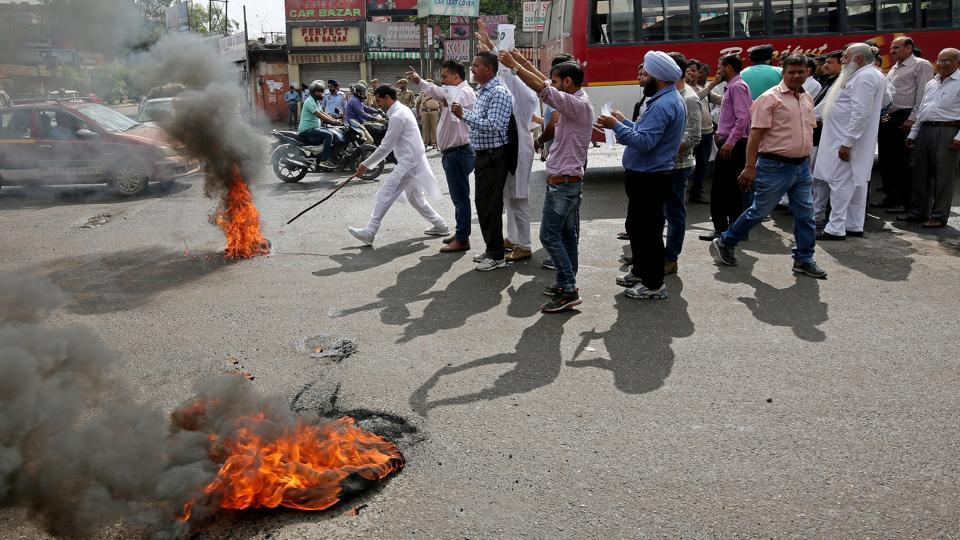 Activists of the National Panthers Party burn tyres and shout slogans during a protest demanding among other things a federal probe into the rape and murder of an eight-year-old girl in Kathua