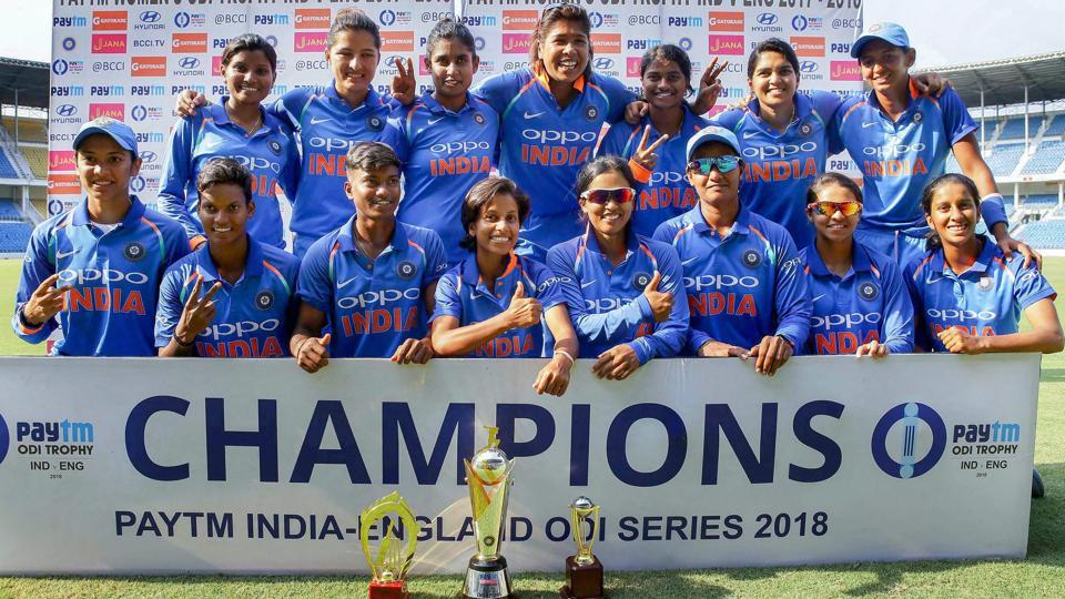 Indian women's cricket team members pose after defeating England by eight wickets in the 3rd ODI in Nagpur on Thursday.