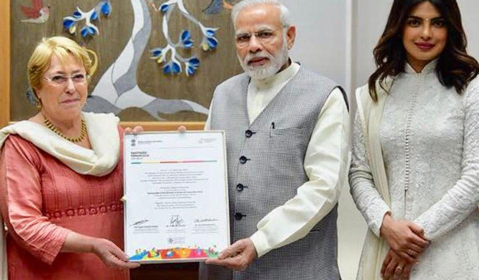 Priyanka Chopra meets Narendra Modi and is dressed in a traditional salwar suit.