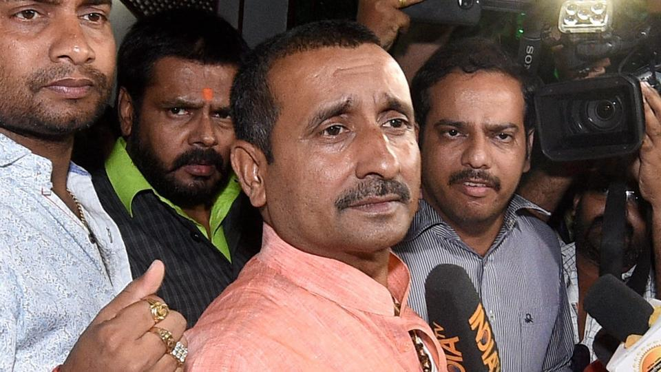 BJP MLA from Unnao, Kuldeep Singh Sengar, stands outside the office of the Senior Superintendent of Police in Lucknow.