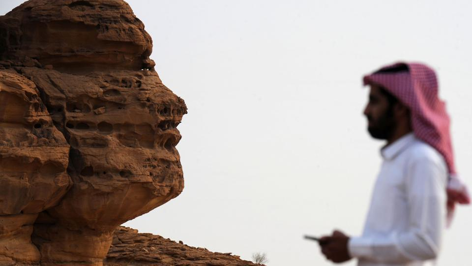 "A Saudi man visits the Khuraiba archaeological site near al-Ula. ""Every day something new is being discovered,"" Jamie Quartermaine, an expert from the Britain-based Oxford Archaeology group, told AFP. The Saudi-Franco partnership is in part aimed at preserving the site from further erosion and vandalism. (Fayez Nureldine / AFP)"