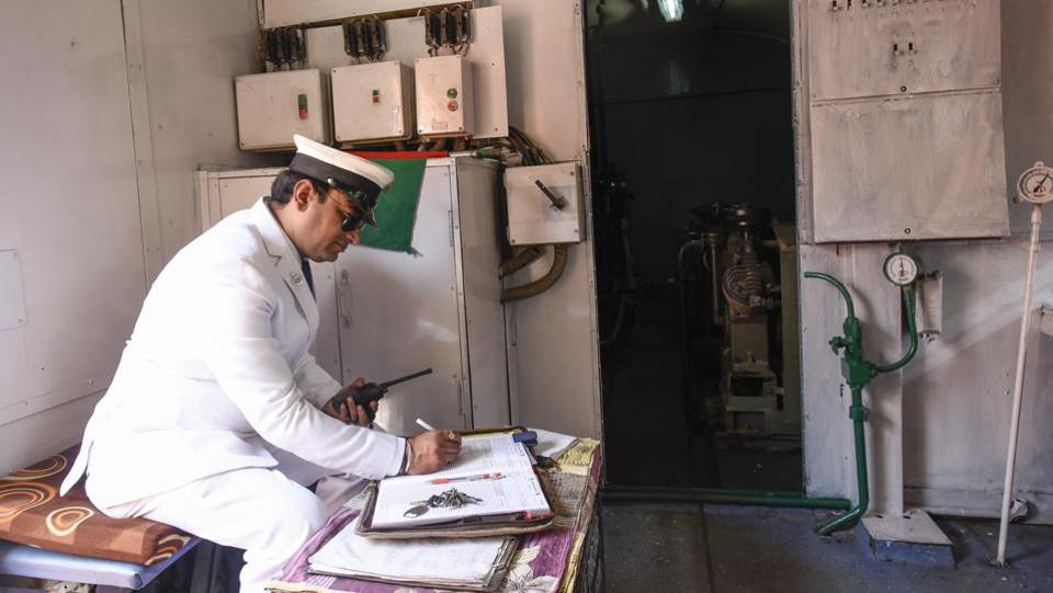 A station manager works on documents inside a compartment during the heritage train's run. Flagging off the train, Ashwani Lohani, Chairman Railway Board said that the Railways is trying to resuscitate its repository of steam engines with plans for special joy ride trains on dedicated routes. The tickets for these runs will be priced to target the general public. (Burhaan Kinu / HT Photo)