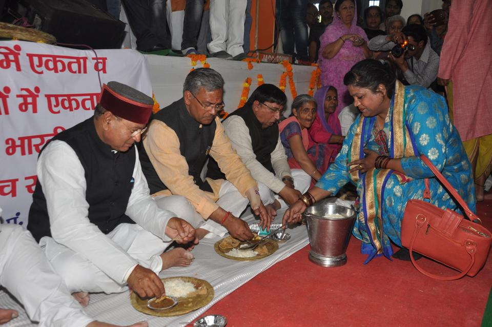 Chief minister Trivendra Singh Rawat and many BJP leaders have meals with Dalits during the 'Samrastra Diwas' (brotherhood day) observed  by the BJP in Dehradun on Friday.