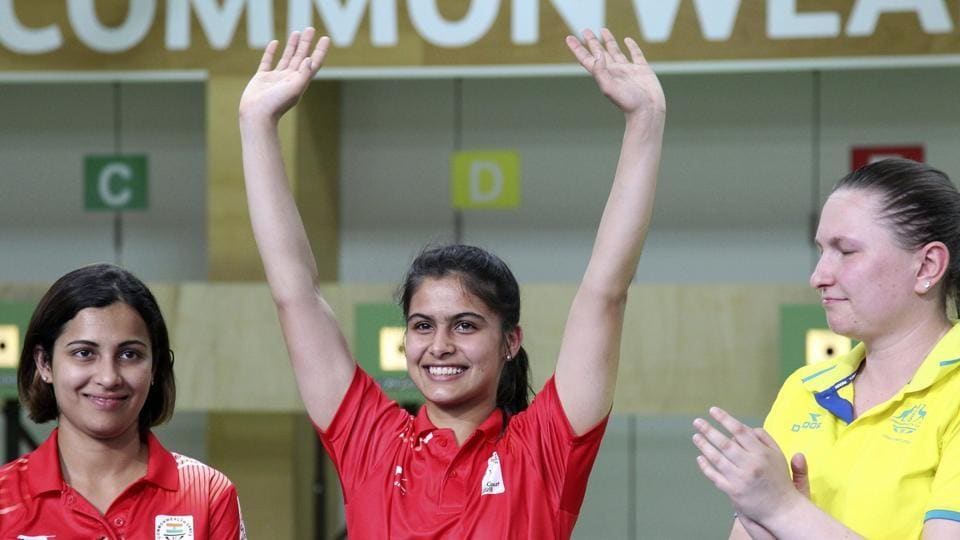 Manu Bhaker of India reacts after winning the gold medal with Heena Sidhu and Australia's Elena Galiabovitch at the Belmont Shooting Centre during the 2018 Commonwealth Games in Brisbane, Australia