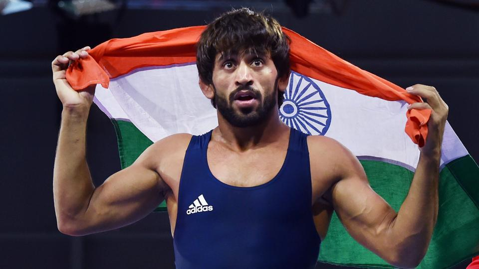 Bajrang Punia celebrates after defeating Wales' Kane Charig to win gold in men's freestyle 65 kg wrestling event, at the Commonwealth Games 2018 in Gold Coast. Anish Bhanwala, also won a gold medal in the 25m rapid fire pistol final, and has become India's youngest ever gold medallist at the Commonwealth Games. (Manvender Vashist / PTI)