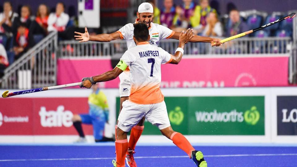 India's Mandeep Singh (back) and Manpreet Singh celebrate a goal during the men's field hockey match between England and India on April 11, 2018. (Anthony Wallace / AFP)