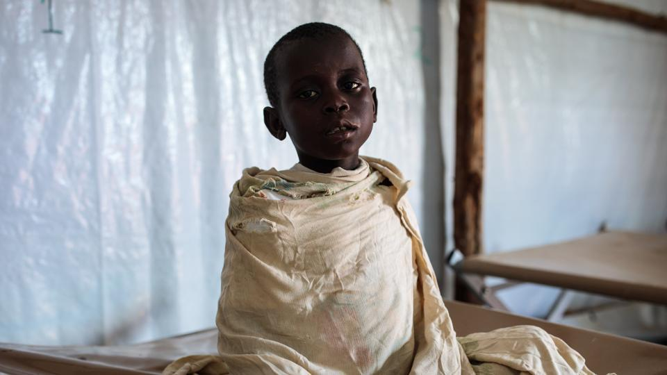 Ivan, a 5-year-old, sits suffering with cholera and malaria in the Kyangwali Refugee Settlement, Uganda. Nearly 70,000 people from the Democratic Republic of Congo have fled to Uganda this year due to ethnic violence and now face a cholera outbreak in settlements that has left at least 42 dead, more than 2,000 severely affected and health workers rushing to stem the spread. (Jack Taylor / Getty Images)