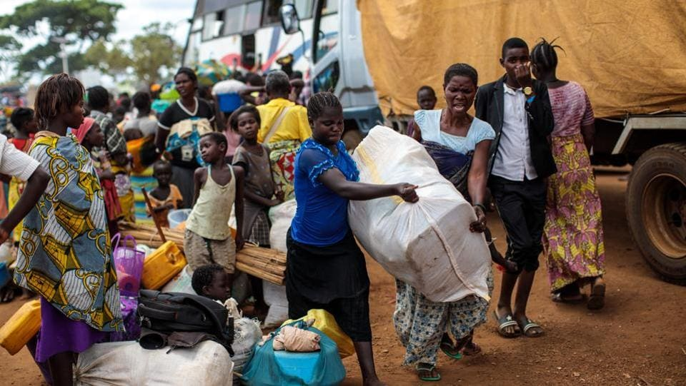 Displaced refugees from the DRC prepare to be resettled at the Kagoma reception centre in Kyangwali. With refugee settlements in Uganda almost at maximum capacity there are plans for new settlements to be built to deal with the continuing influx of people. (Jack Taylor / Getty Images)
