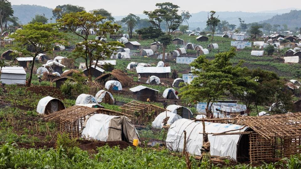 Shelters for refugees stand on a hill in the Kyangwali Refugee Settlement. People are sleeping back-to-back in makeshift hangars as reception centres along the shore of the lake are overwhelmed, according to Medecins Sans Frontieres, which said the risk of a measles outbreak in the camps is also high. (Jack Taylor / Getty Images)