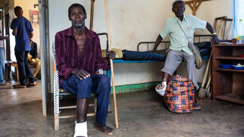 Two refugees who injured their feet fleeing are pictured in a ward at the Rwenyawawa Health Centre in the refugee settlement. Hema and Lendu groups have a long history of violence but in the late 90s and early 2000s their fight became a broader, brutal battle stoked by Rwanda and Uganda, seeking gold, diamond and timber along with influence in a wider war that played out in the DRC. (Jack Taylor / Getty Images)