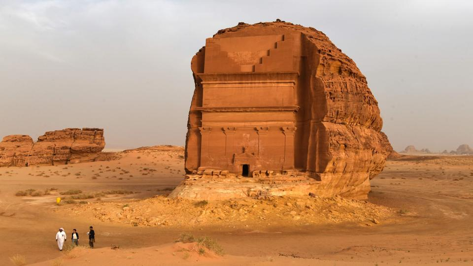 The Qasr al-Farid tomb (The Lonely Castle) carved into rose-coloured sandstone in Madain Saleh, a UNESCO World Heritage site, stands in the dunes near al-Ula. Saudi Crown Prince Mohammed bin Salman signed a landmark agreement with Paris on Tuesday for the touristic and cultural development of the northwestern site, once a crossroads of ancient civilisations. (Fayez Nureldine / AFP)