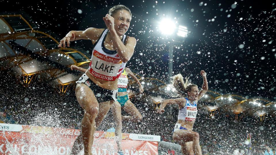 Athletes compete in the women's 3000m steeplechase final during the 2018 Gold Coast Commonwealth Games at the Carrara Stadium on the Gold Coast. (Adrian Dennis / AFP)