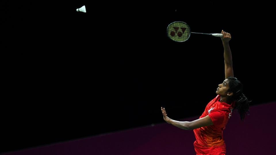 India's Venkata Pusarla hits a return against Australia's Hsuan-Yu Wendy Chen during their women's badminton singles round of 16 match on April 12, 2018. (Ye Aung Thu / AFP)