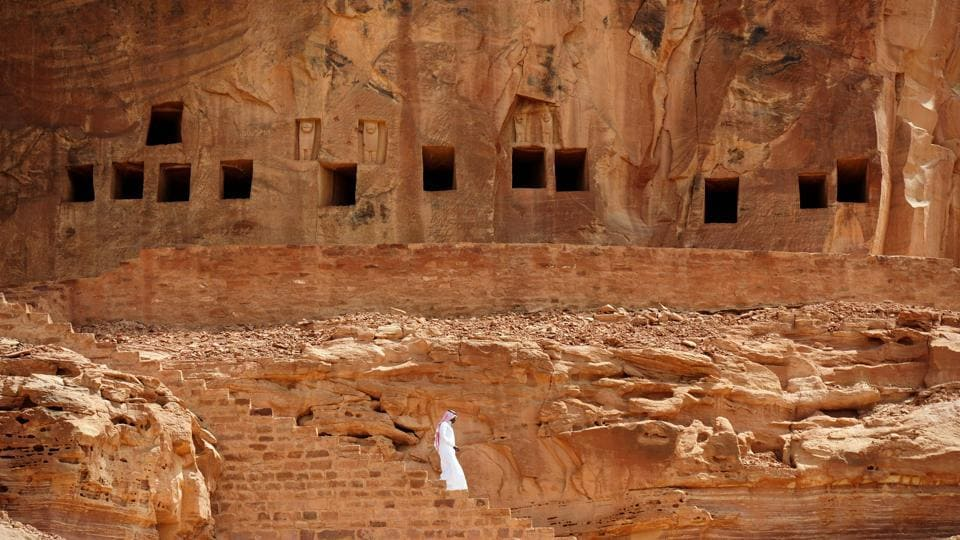 A man walks near ancient tombs at the Khuraiba. But before a preservation plan is launched all archaeological treasures need to be accounted for, said Amr al-Madani, head of the Royal Al-Ula Commission. A massive two-year surveying programme began in March, which includes scanning via helicopters, satellites, drones and remote sensing Lidar.  (Fayez Nureldin / AFP)
