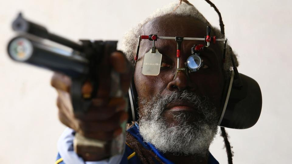 Barbados' Bernard Chase is pictured as he takes part in the 10m air pistol men's qualification shooting final at the Belmont Shooting Complex in Brisbane on April 9, 2018. (Patrick Hamilton / AFP)