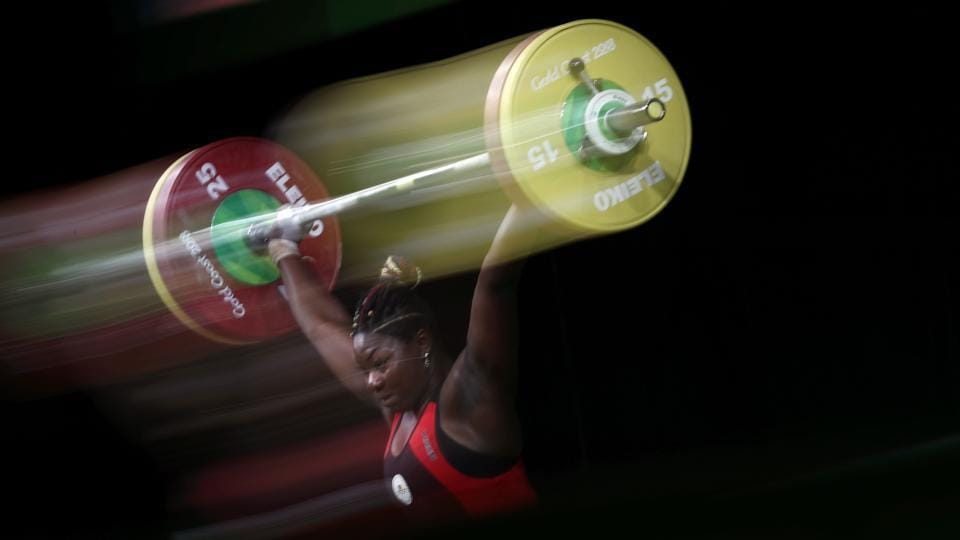 Cameroon's Clementine Meukeugni Noubissi competes during the women's 90kg weightlifting final on April 9, 2018. (Adrian Dennis / AFP)