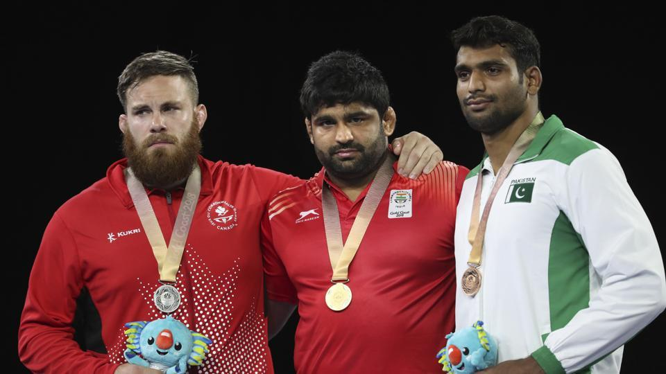 Indian wrestler Sumit Malik claimed a gold in men's freestyle 125 kg after his opponent, Nigeria's Sinivie Boltic was ruled out of the final due to an injury. (AP)