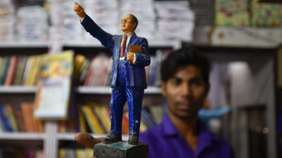 Ambedkar who was independent India's first law minister and the principal architect of the Constitution, is now fast becoming a pop culture icon whose face, as they once said about Che Guevara, can launch a thousand T-shirts. His image features not just on tees, but on a range of accessories --rings, earrings, wristwatches, bracelets, lockets-- all of which are selling like hot cakes, thanks to a new generation of assertive Dalits who like to flaunt their identity. (Raj K Raj / HT Photo)