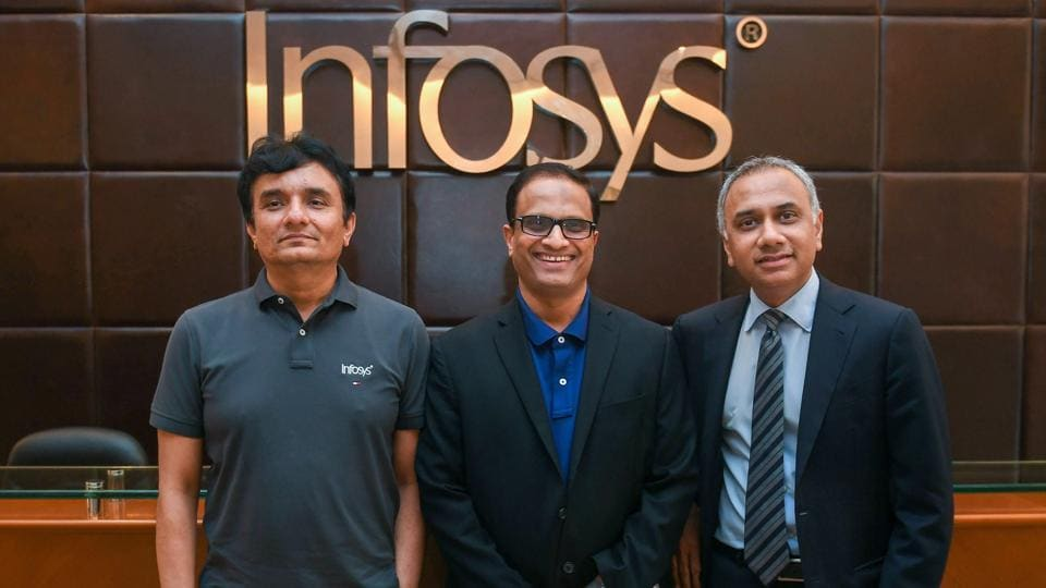 Infosys CEO Salil Parekh (right), COO Pravin Rao (centre) and CFO MD Ranganath (left) during the announcement of the Annual Financial results of the company at its headquarters in Bengaluru. The IT firm said its board had agreed to pay out a total dividend of Rs 33.50 per share.
