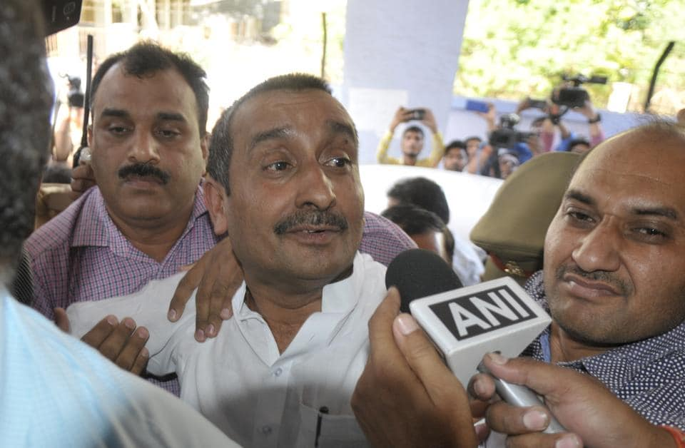 BJP MLA Kuldeep Singh Sengar reacts after being produced at CBI court in Lucknow, in connection with the Unnao rape case.