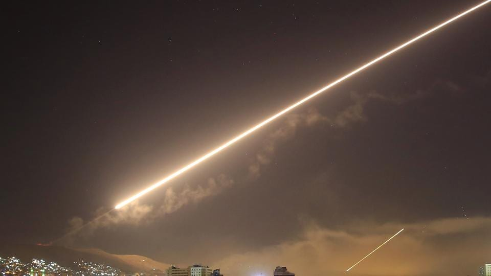 Damascus skies erupt with service to air missile fire as the US launches an attack on Syria targeting different parts of the capital city on Saturday.