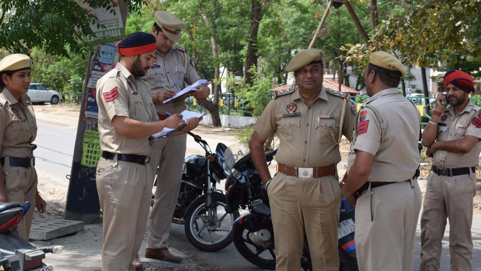 Police officials at the spot of Parmish Verma's shooting in Mohali on Saturday.