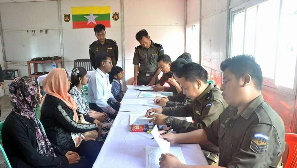 Photo posted alongside the Myanmar government's statement shows one man, two women, a young girl and a boy receiving the ID cards.