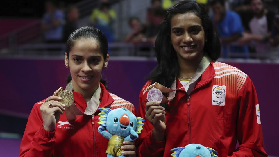 India's Saina Nehwal (L) and PVSindhu after the women's singles badminton final at Carrara Sports Hall during the 2018 Commonwealth Games on the Gold Coast, Australia on April 15, 2018.