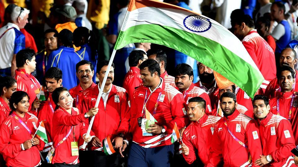 Flag-bearer MC Mary Kom leads the Indian contingent during the closing ceremony of 2018 Commonwealth Games 2018 in Gold Coast on Sunday. (PTI)