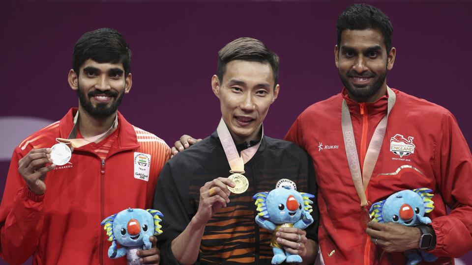 Lee Chong Wei (C), who has now won three Commonwealth Games men's singles gold medals, was too much to handle for Srikanth (L).  (REUTERS)