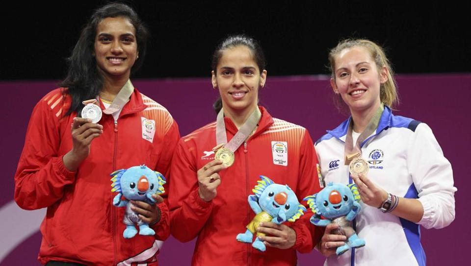 Saina Nehwal (C), PV Sindhu (L) and Kirsty Gilmour pose with their medals.  (REUTERS)