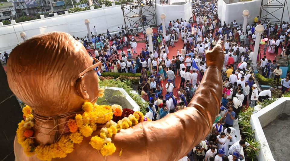People gather at a statue of Dr BR Ambedkar at Pimpri in Pune, on the occasion of his 127th birth anniversary on April 14, 2018.