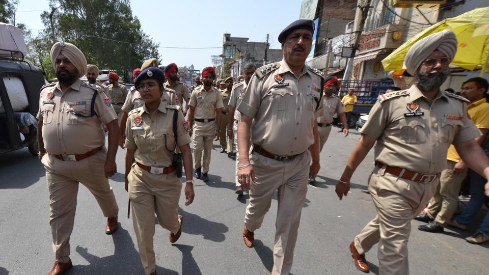 Police personnel take out a flag march following clashes in Phagwara between two groups, in Jalandhar on Sunday.