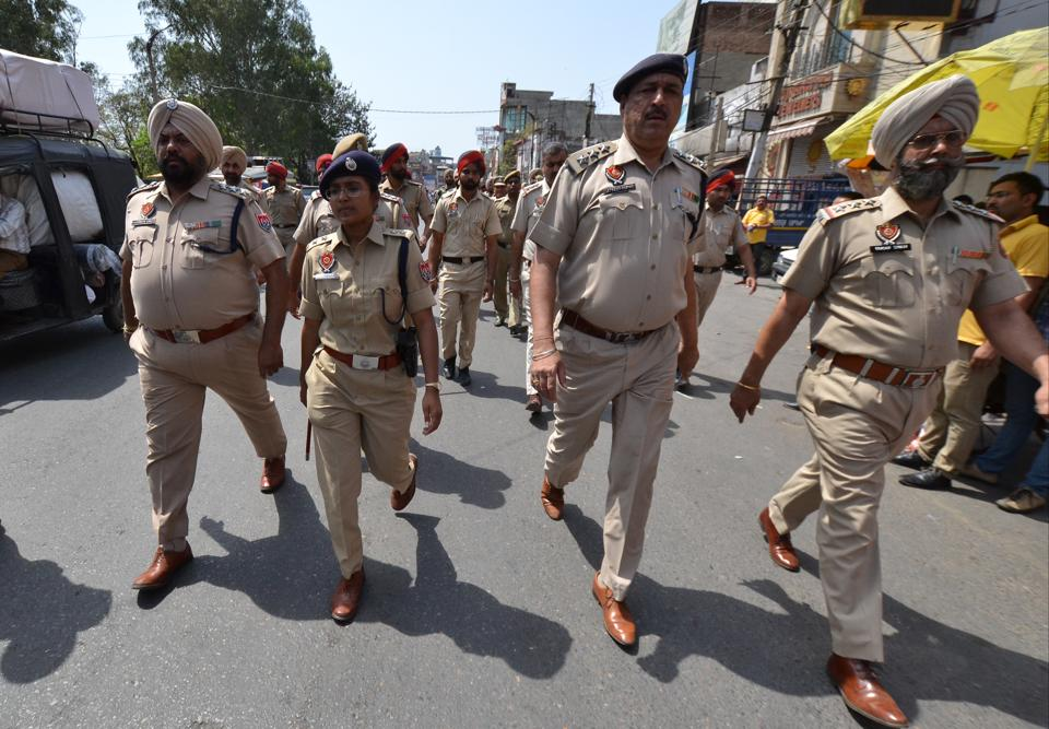 Police personnel taking out a flag march after the clash in Phagwara between Dalit and right-wing Hindu groups in Jalandhar.