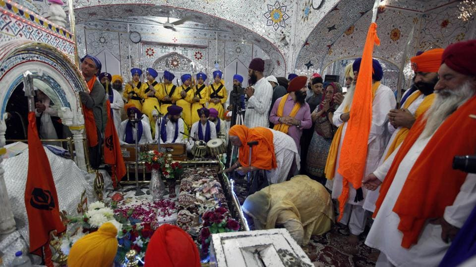 Sikh pilgrims pray during the Baisakhi festival at the shrine of Gurdwara Punja Sahib, the second most sacred place for Sikhs, in Hasan Abdal, some 50 kilometers from Islamabad, in Pakistan, on April 14, 2018. Thousands of Sikh pilgrims arrived from India and other countries to attend the harvest festival that is regionally known by many names and marks the Solar New Year.